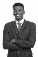 Young happy African businessman in black and white