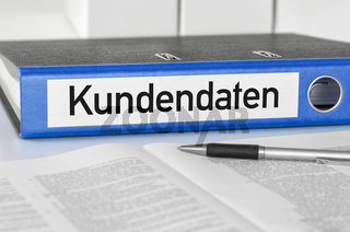 A blue folder with the label Customer data - Kundendaten (German)