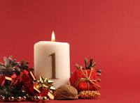 White candle with the number one burns, Advent background