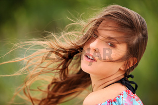 Young woman smiling with windswept hair