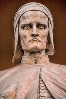 padua, italy - 19.03.2019 - old statue of dante alighieri in front of the loggia amulea