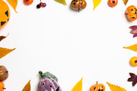 Halloween concept. Pumpkin and autumn leaves on white background. flat lay, top view, copy space
