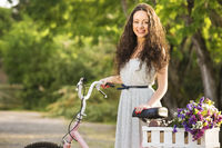 Happy girl with her bicycle