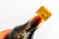 Soy sauce in glass bottle. Traditional asian seasoning.