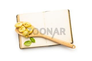 Tortellini pasta and blank cookbook. Italian stuffed pasta
