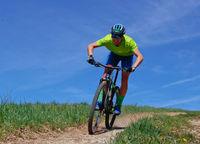 Mountainbiker on high speed downhill