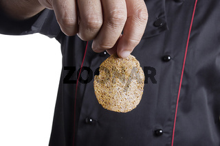 Man's hand with rye chips