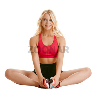 Image of charming blonde training stretching