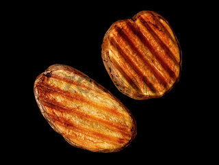 Two slices of grilled potatoes rotated