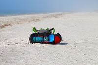 Two big backpacks with sleeping pad on sand at summer