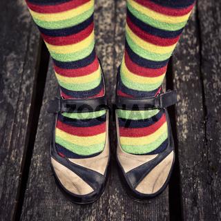 Female legs in striped socks in vintage style