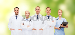 group of doctors with stethoscopes and clipboard