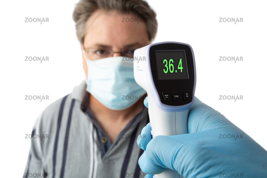 A man is temperature checked for fever or high temperature