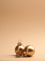Golden vintage Christmas baubles on a beige background