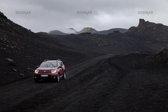 car in black lava landscape, Landmannaleid, Krókagiljabrún, near Hekla, Iceland, Europe