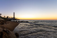 A horizontal view of the Chipiona lighthouse in Andalusia at sunset