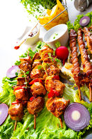 Grilled szaszlyk and meat flares with green salad
