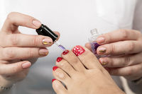 Pedicure Master does the procedure to the client