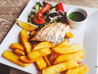 Grilled chicken, french fries and salad for lunch