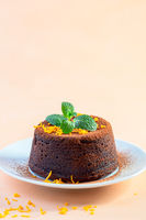 Chocolate cake with cocoa powder and orange peel.