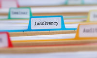 File folders with a tab labeled Insolvency