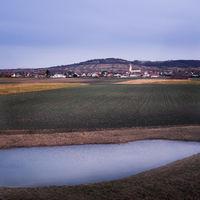 Village Schützen am Gebirge with small pond in front