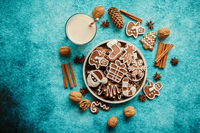 Sweet Christmas composition. Assortment of gingerbread cookies on a plate