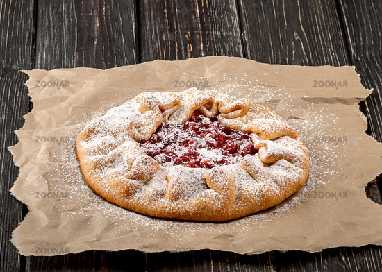 Galetta open gooseberries pie on paper