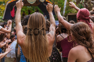 Diverse people dance at earth festival