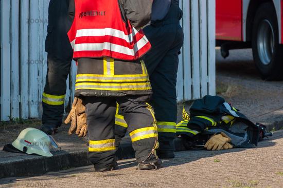 legs of three firemen after an operation