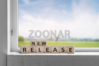 New release sign in a window on a sill