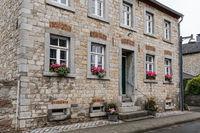Facade of historical mansion house with flowered window sills. Alt Breinig, DE.