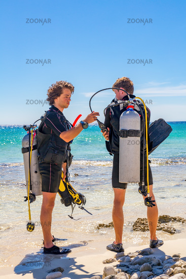Dutch divers check diving equipment at coast