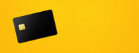 Black credit card on yellow background