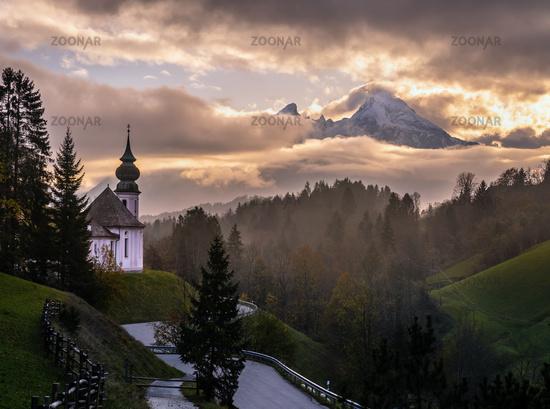 Maria Gern pilgrimage church and mount Watzmann top silhouette through fog, Berchtesgaden, Germany