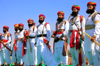 Indian men in traditional dress taking part in Mr Desert competition, Jaisalmer, India