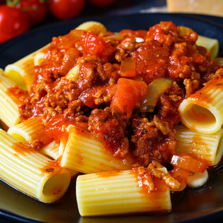 Rigatoni pasta with Bolognese sauce and fresh basil