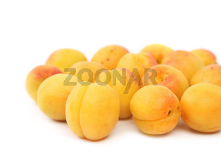 lots of fresh apricots isolated on white