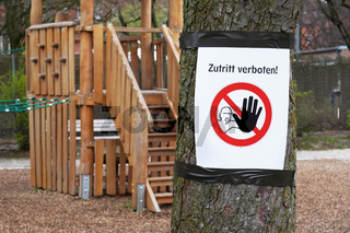 Closed playground with Zutritt verboten sign - meaning no entry in German