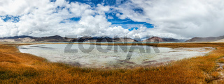 Panorama of Tso Kar - fluctuating salt lake in Himalayas. Rapshu