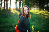 woman walking early in summer forest area