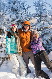 Three friends enjoy snow winter holiday mountains