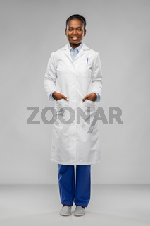 happy african american female doctor or scientist