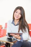 Asiatisches Mädchen im Unterricht