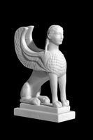 statuette of a sphinx on a black background
