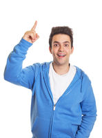 Hispanic guy pointing upwards