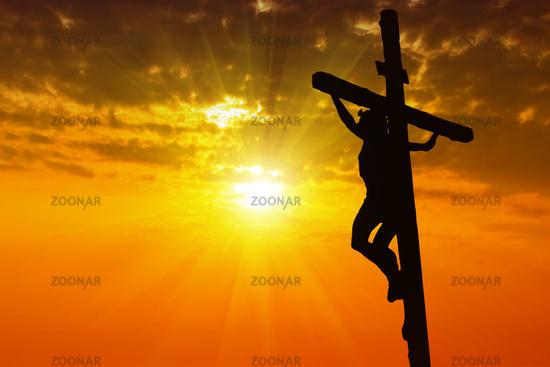 Silhouette Jesus Christ crucifixion on cross