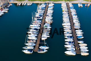Boats moored at dock in Lovere port