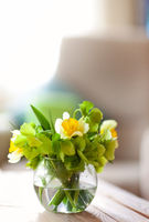 Fresh flowers in round vase