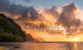 Sunset over the receding mountains of the Na Pali coast of Kauai in Hawaii